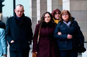 The family of Charlotte Brown, father Graham Brown (left) sister Katie (2nd left) and mother Roz Wickens (right), who died following a speedboat crash.  Yui Mok/PA Wire