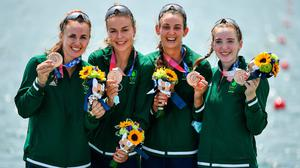 Aifric Keogh, Eimear Lambe, Fiona Murtagh and Emily Hegarty celebrate on the podium with their bronze medals after finishing 3rd place in the Women's Four final. Photo by Seb Daly/Sportsfile