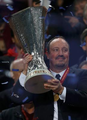 Chelsea's manager Rafael Benitez holds the trophy