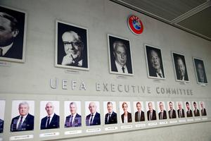 SHOW MUST GO ON: Members of the Executive Board of the UEFA are pictured on a wall in Nyon, Switzerland. Photo: REUTERS/Denis Balibouse