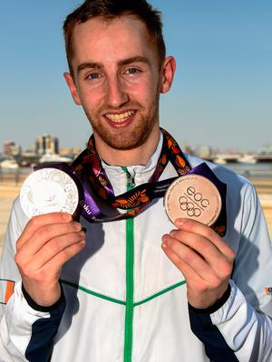 Sam Magee with his two bronze medals for Badminton Men's and Mixed Doubles