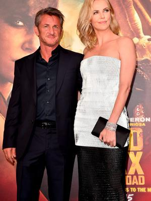 """Actors Sean Penn (L) and Charlize Theron attend the premiere of Warner Bros. Pictures' """"Mad Max: Fury Road"""" at TCL Chinese Theatre on May 7, 2015 in Hollywood, California.  (Photo by Kevin Winter/Getty Images)"""