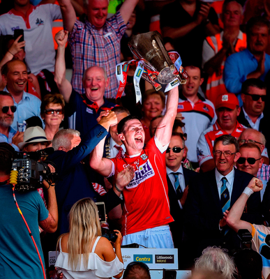 REBEL YELL: Cork captain Seamus Harnedy lifts the cup following the Munster Hurling Final win over Clare in Thurles. Photo by David Fitzgerald/Sportsfile