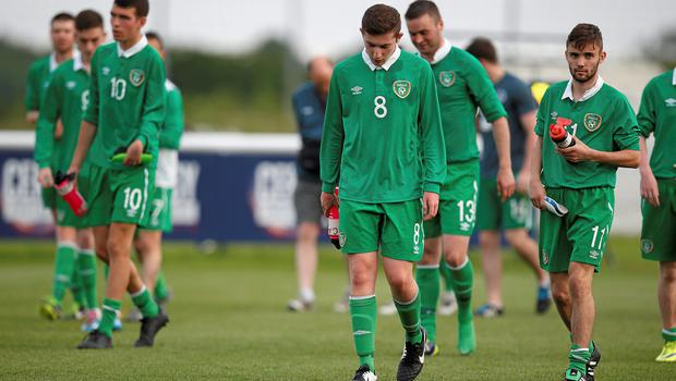Dejected Ireland players at the end of the game