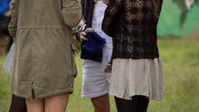 Cressida Bonas chats to friends in the hospitality area at Glastonbury music festival