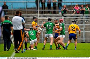 24 May 2015; Clare and  Limerick players tussel with each other moments before half time. Referee Colm Lyons issued a red card to Patrick Donnellan shortly after. Munster GAA Hurling Senior Championship Quarter-Final, Clare v Limerick. Semple Stadium, Thurles, Co. Tipperary. Picture credit: Ray McManus / SPORTSFILE