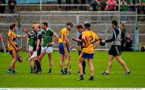 24 May 2015; Referee Colm Lyons speaks to Clare's Patrick Donnellan, 8, before issuing him a red card on the stroke of half time.  Munster GAA Hurling Senior Championship Quarter-Final, Clare v Limerick. Semple Stadium, Thurles, Co. Tipperary. Picture credit: Ray McManus / SPORTSFILE