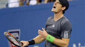 Andy Murray reacts in the third set during his quarter-final men's single match against Novak Djokovic at the 2014 U.S. Open. Photo credit: REUTERS/Ray Stubblebine
