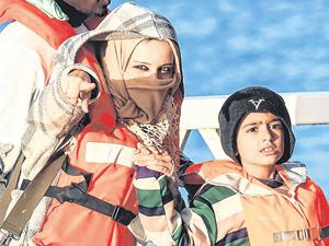 Hope: A mother and a child disembark from a patrol boat in Malta. Photo: Matthew Mirabelli / AFP