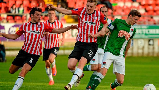 Garry Buckley retains possession despite pressure from Derry's Philip Lowry and Ronan Curtis
