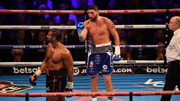 British boxer David Haye (L) walks back to his corner after the round has ended as compatriot Tony Bellew (C) gestures during their heavyweight boxing match at the O2 Arena in London on March 4, 2017. JUSTIN TALLIS/AFP/Getty Images