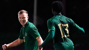 Ireland's Jamie Lennon  celebrates after scoring his side's second goal with team-mate Joshua Ogunfaolu-Kayode, 13.