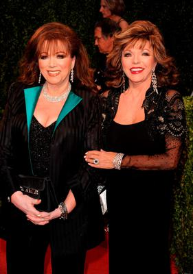 In this Feb. 22, 2009 file photo, actress Joan Collins, right, poses with her sister, author Jackie Collins at the Vanity Fair Oscar party in West Hollywood, Calif. Jackie Collins, died in Los Angeles on Saturday, Sept. 19, 2015, of breast cancer. She was 77. (AP Photo/Evan Agostini, File)