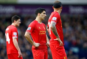 Liverpool's Luis Suarez (C) reacts during their English Premier League soccer match against West Bromwich Albion at the Hawthorns in West Bromwich,