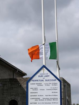 The Tricolour flies at half mast as a Book of Condolences was opened for the victims of the California balcony collapse at Our Lady of Perpetual Succour Church, Foxrock this afternoon...Picture Colin Keegan, Collins Dublin.