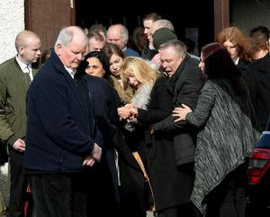 14 March 2017;  General view of family and mourners after funeral mass. Funeral of Karl Robertson. St. Luke the Evangelist Church, Kilmore West, Coolock, Dublin. Picture: Caroline Quinn