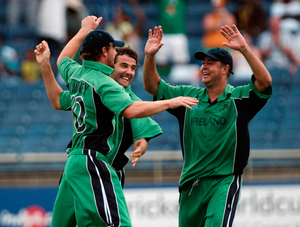 John Mooney, Ireland, celebrates with team-mates Kyle McCallan, centre, and Dave Langford-Smith, right, after catching off Umar Giul, Pakistan. ICC Cricket World Cup, Group D, Ireland v Pakistan, Sabina Park, Kingston, Jamaica. Picture credit: Pat Murphy / SPORTSFILE