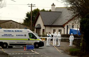 Forensic gardai at thee scene of his shooting. Photo: Gerry Mooney
