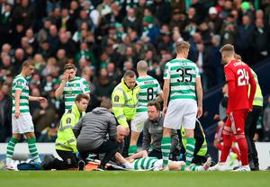 HORROR BLOW: Ryan Christie receives treatment. Photo: Ian MacNicol/Getty Images