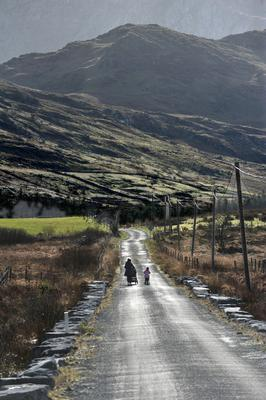Improved weather: A mother and daughter adhere to social distancing guidelines as they push their prams in the open countryside in Connemara yesterday. Photo: Ray Ryan