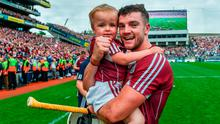 Adrian Tuohy of Galway with son Jamie after winning the All Ireland