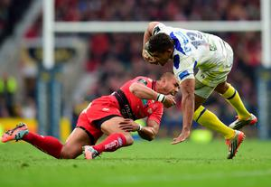 Clermont's Wesley Fofana tackled by Rudi Wolff of Toulon