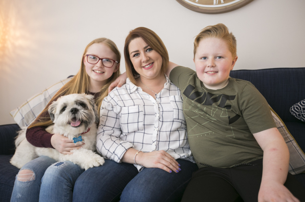 Belfast mum Lisa Hewitt with her children Sophie and Kyle and their dog Ted.