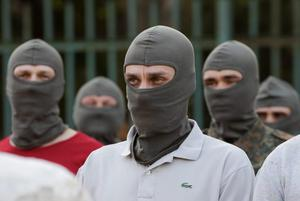 """Volunteers stand in formation before a training session at the base of Ukrainian self-defence battalion """"Azov"""" in the southern coastal town of Mariupol"""