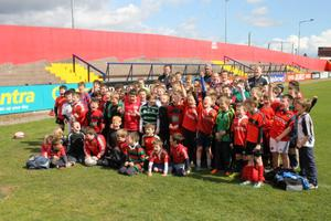 Munster's Denis Hurley, Simon Zebo and John Ryan meet the young players at last year's Easter Rugby Camps