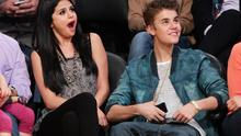 Selena Gomez (L) and Justin Bieber attend a basketball game between the San Antonio Spurs and the Los Angeles Lakers at Staples Center on April 17, 2012 in Los Angeles, California.  (Photo by Noel Vasquez/Getty Images)
