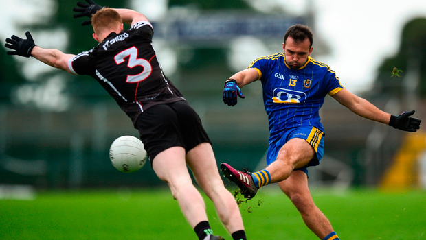 Donie Smith of Roscommon in action against Peter Laffey of Sligo. Photo by David Fitzgerald/Sportsfile