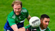 Ben McCormack of Sarsfields in action against Seamus McNally of Johnstownbridge