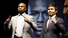 """Eleven-time, five-division world boxing champion Floyd """"Money"""" Mayweather (L) and eight-division world champion Manny """"Pac-Man"""" Pacquiao pose at a news conference ahead of their upcoming bout, in Los Angeles"""