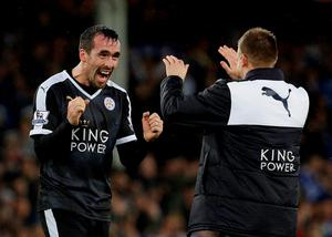 Leicester's Christian Fuchs celebrates with Marc Albrighton after the game. Photo: Craig Brough/Action Images via Reuters