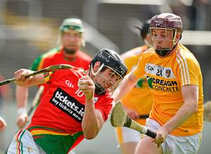 Carlow's Sean Murphy in action against Eoghan Campbell and Conor McKinley of Antrim