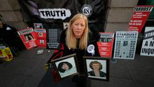Antoinette Keegan, whose sisters Mary and Martina were among the 48 victims of the Stardust nightclub fire in Dublin on Valentine's Day in 1981, holds a picture of them outside Leinster House in Dublin. Niall Carson/PA Wire