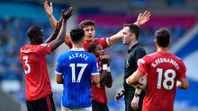 Man United were awarded a penalty with the last kick of the game after Neal Maupay handled a Harry Maguire header. Glyn Kirk/NMC Pool/PA Wire.