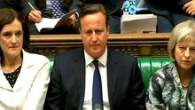 Prime Minister David Cameron looks on during Prime Minister's Questions in the House of Commons