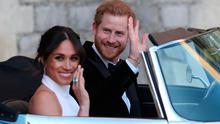 Prince Harry and Meghan Markle drive off in an E-Type Jaguar after their wedding