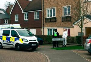 Police outside the address in Farnham,  where the murder suspect and a 27-year-old woman were arrested by police at 6am on Saturday following the stabbing of  Lee Pomeroy on a train in Surrey Credit: Lizzie Roberts/PA Wire