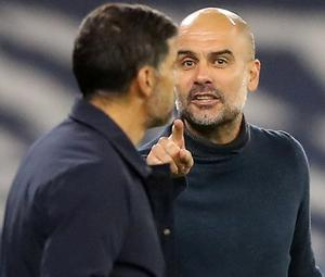 Pep Guardiola and Sergio Conceicao