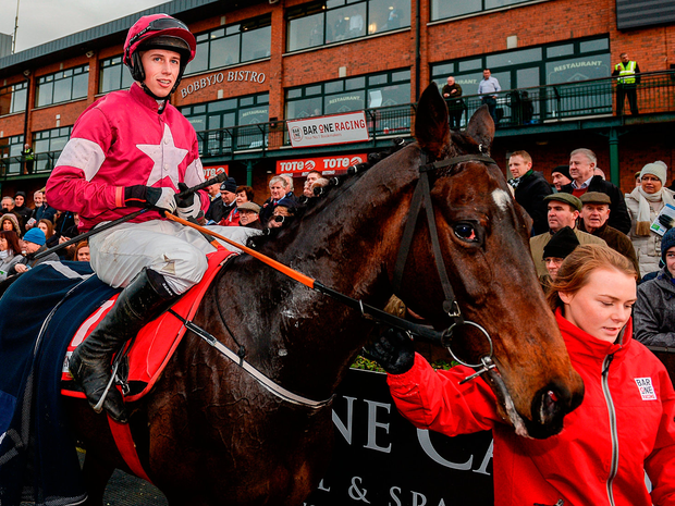 Bryan Cooper enters the parade ring on Apple's Jade after landing the Bar One Racing Hatton's Grace Hurdle at Fairyhouse. Photo: Cody Glenn/Sportsfile