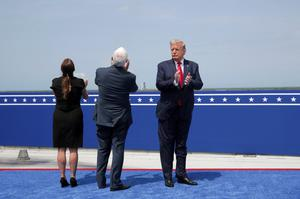 U.S. President Donald Trump, U.S. Vice President Mike Pence and his wife Karen Pence applaud after the launch of a SpaceX Falcon 9 rocket and Crew Dragon spacecraft on NASA's SpaceX Demo-2 mission to the International Space Station from NASA's Kennedy Space Center in Cape Canaveral, Florida, U.S.  May 30, 2020. REUTERS/Jonathan Ernst