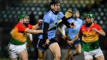 Ronan Hayes of Dublin in action against Gary Bennett, left, and David English of Carlow. Photo: David Fitzgerald/Sportsfile