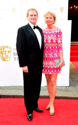 Hugh Bonneville and Lulu Williams arrive for the House of Fraser British Academy of Television Awards at the Theatre Royal, Drury Lane in London. PRESS ASSOCIATION Photo. Picture date: Sunday May 10, 2015. See PA story SHOWBIZ Bafta. Photo credit should read: Ian West/PA Wire