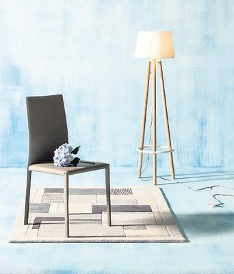 Terence Conran interprets industrial light in this 'Tadema' tripod lamp, €270, and modestly styled 'Neiland' dining chairs, €459 for two, M&S