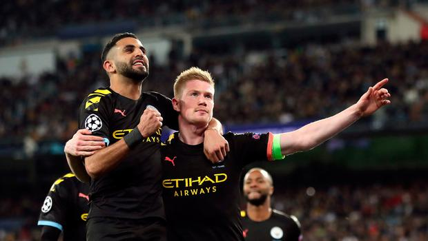 Manchester City's Kevin De Bruyne (right) celebrates scoring the winning goal against Real Madrid at the Bernabeu. Nick Potts/PA Wire