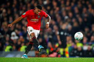 Manchester United's Marcus Rashford scores their second goal in the Carabao Cup fourth round win over Chelsea at Stamford Bridge, London