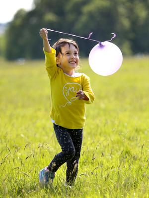 Four year old Genette Henry from Cabinteely pictured in  the sunshine at Dublin's Pheonix Park. Pic Frank Mc Grath