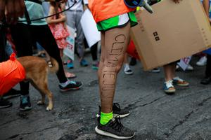 "An environmental activist with the words ""Climate Justice"" written on her leg participates in a Global Climate Strike near the Ministry of Natural Resources and Environment office in Bangkok, Thailand September 20, 2019. REUTERS/Soe Zeya Tun"